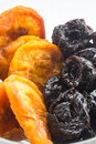 Dried fruit in dish macro image of peaches and prunes Stock Images