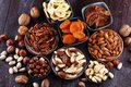 Dried fruits and assorted nuts composition on rustic table Royalty Free Stock Photo