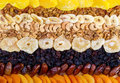 Dried fruits assortment on wooden background. Top view Royalty Free Stock Photo