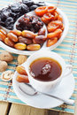 Dried Fruits And Cup Of Tea Royalty Free Stock Photos