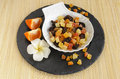 Dried fruits dark stone plate flower mandarines makisu Royalty Free Stock Images