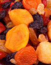 Dried fruits heap of delicious sweet with apricot cherry black and white raisins closeup Royalty Free Stock Photo