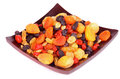 Dried fruits heap of various with apricot and cherries black and white raisins on brown square wooden plate isolated on Royalty Free Stock Photography