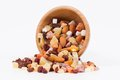 Dried fruits and nuts in a bambus bowl on white background with for healthy diet Royalty Free Stock Images