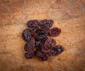 Dried grapes on wooden table Royalty Free Stock Images