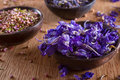 Dried larkspur petals closeup on blue alternative medicine pot pourri decoration wedding confetti copy space Stock Photo