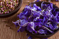 Dried larkspur petals closeup on blue alternative medicine pot pourri decoration wedding confetti copy space Stock Image