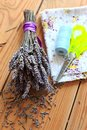 Dried lavender bouquet scissors and cloth on the wooden table Stock Photography