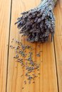 Dried lavender bouquet on the wooden table and little flowers Stock Image