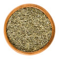 Dried minced thyme in wooden bowl over white Royalty Free Stock Photo
