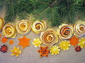 Dried orange fruits flowers different shape on linen fabric Royalty Free Stock Photo