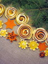 Dried orange fruits flowers and fir tree branches on linen fabric Stock Image