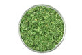 Dried parsley in glass plate on white background Royalty Free Stock Image