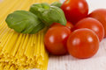 Dried pasta background of spaghetti with basil Stock Photography