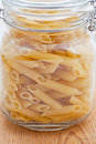 Dried pasta tubes in a glass jar Royalty Free Stock Photos