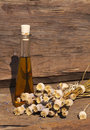Dried poppy capsules and poppy oil summer harvest of on a wooden table in front of a garden shed Stock Images