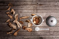 Dried porcini soaking mushrooms and in the water overhead shot Royalty Free Stock Photo