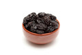 Dried prunes in bowl on white background close up Royalty Free Stock Photography