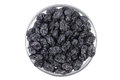 Dried raisins in a glass on white background Royalty Free Stock Photography