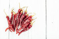 Dried red pepper peppers on a white barnwood table Stock Photography