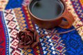 Dried red rose and a brown clay tea Cup Royalty Free Stock Photo