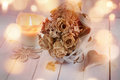 Dried rose bouquet on rustic wood Royalty Free Stock Photo