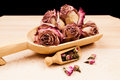 Dried roses and buds with wooden objects texture Royalty Free Stock Photo