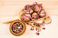 Dried roses and buds with wooden objects texture Royalty Free Stock Image