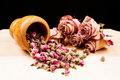 Dried roses and buds with wooden objects wooden texture Stock Photo