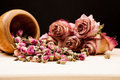 Dried roses and buds with wooden objects wooden texture Stock Photography