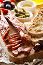 Dried sausage and country bread on wooden board Royalty Free Stock Photo