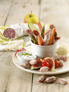 Dried sausage and raw vegetables with creamy dip Stock Photography