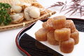 Dried scallop and raw scallop on traditional japanese plate Royalty Free Stock Images