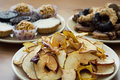 Dried sliced apples and tasty cookies on a plate Royalty Free Stock Photos