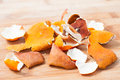Dried tangerine peel on chopping board Stock Photo