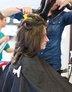 Dries in hair salon woman hairdressing Royalty Free Stock Photo