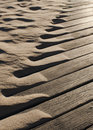 Drifting beach sand abstract blowing up on to boardwalk Royalty Free Stock Photos