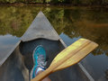 Drifting canoe in an old metal on a glassy peaceful lake Stock Photos