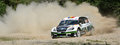 Drifting rally car throwing dust in the back Stock Images
