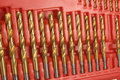 Drill bits set of titanium in a red plastic case Stock Images