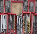 Drill bits various tools in boxes Royalty Free Stock Image