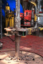 Drill pipe and rig tong on the rig floor while making up for drilling Stock Photo