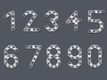Drilled metallic numbers design dark background Stock Photography