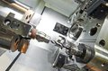 Drilling process of metal on machine tool Royalty Free Stock Photo