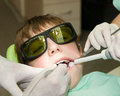 Drilling of tooth young boy during Stock Image