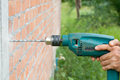 Drilling the wall with electric drill 1 Royalty Free Stock Photo