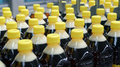 Drink bottled production detail yellow caps Royalty Free Stock Images