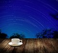 Drink coffee cup with star trails in night sky Royalty Free Stock Photo
