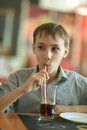 Drink coke in cafe young cute boy Royalty Free Stock Photo