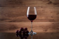 Drink and food. Wineglass, with red  wine and red grapes Royalty Free Stock Photo